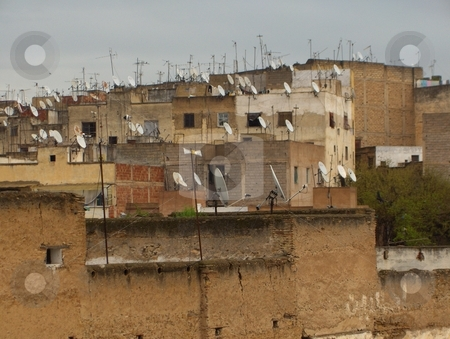 Progress stock photo, Satellite television dishes on the roofs of ancient buildings in Morocco by Jessica Tooley