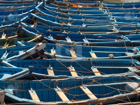 Fishing Boats stock photo, Blue painted fishing boats in harbour. by Jessica Tooley