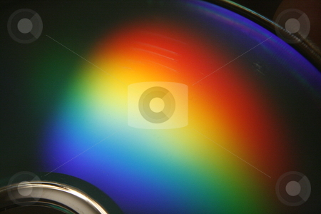 Spectrum stock photo, Rainbow of light reflected on the surface of a compact disc. by Nathan Smith
