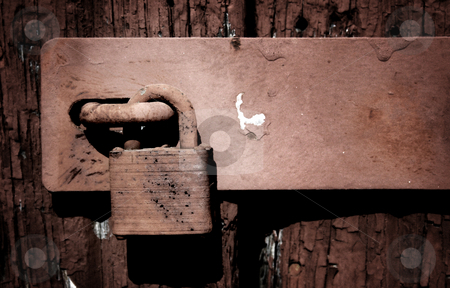 Painted Padlock stock photo, Rusty, painted padlock on a weathered wooden door. by Nathan Smith