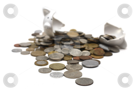 Broken Piggy Bank stock photo, A broken piggy bank isolated on a white background with loads of coins from around the world. by Daniel Wiedemann