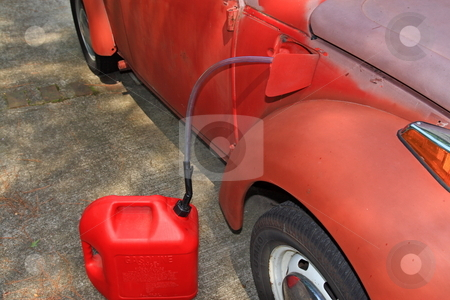 Gas Theft stock photo, With the Gas prices reaching to the all time high of 3.97 in the Atlanta Ga area gas theft of the older cars with out locking gas doors is on the raise by Jack Schiffer