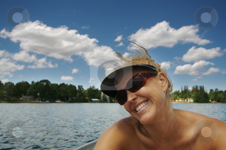 Day on the Lake stock photo, Beautiful woman enjoys a summer day on the lake. by Andy Dean