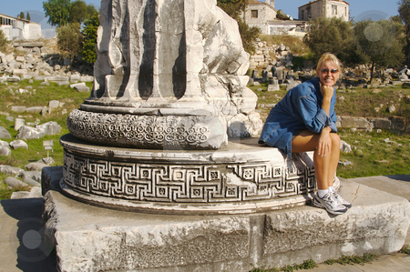 Attractive Tourist Rests on Ruins stock photo, Attractive Tourist Rests on Ruins by Andy Dean