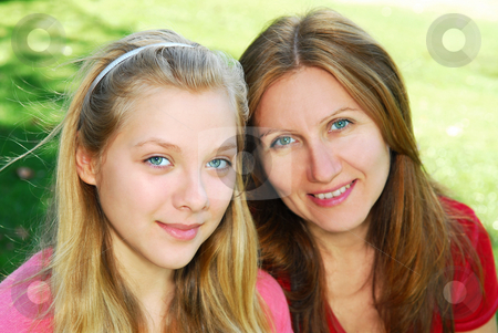 Mother and daughter stock photo, Portrait of a smiling mother and teenage daughter in summer park by Elena Elisseeva