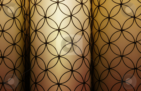 Candlelit Pattern stock photo, Three candles with intricate exterior design. by Nathan Smith