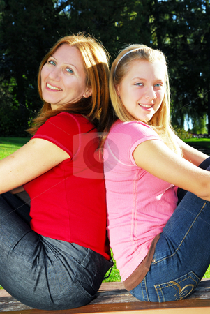 Mother and teenager daughter stock photo, Portrait of a mother with teenage daughter relaxing in summer park by Elena Elisseeva