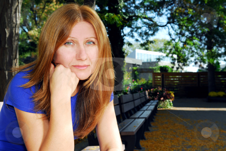 Sad woman stock photo, Mature woman looking sad and tired sitting on a park bench by Elena Elisseeva