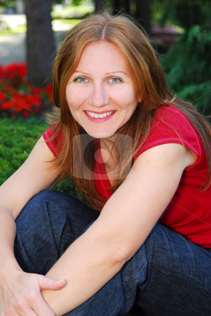 Smiling woman stock photo, Portrait of a smiling mature woman outside by Elena Elisseeva