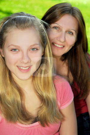 Mother and daughter stock photo, Portrait of smiling family of mother and her teenage daughter by Elena Elisseeva
