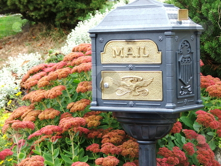 Classy Mailbox stock photo, A unique mailbox  on a habor side street in Boothbay Harbor, Maine  attracts appreciative looks from passerbys. by Dennis Thomsen