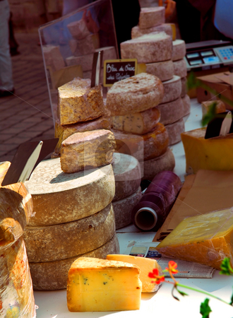 Cheeses on the market stock photo, Assorted cheeses for sale on french farmers market in Perigueux, France by Elena Elisseeva