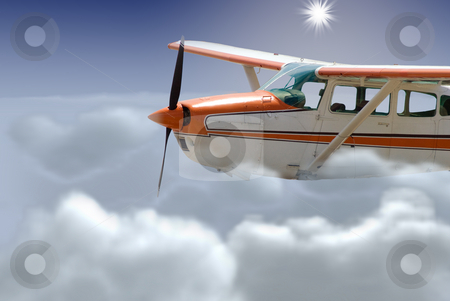 Flying stock photo, A small plane flying just above the clouds by Richard Nelson