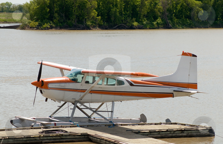 Small Plane stock photo, A small aeroplane docked on a river by Richard Nelson