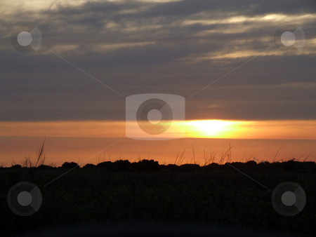 Sunset Over San Luis Pass stock photo, Sun setting over San Luis Pass Texas by Marburg