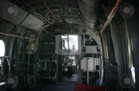 Old Helicopter stock photo, The inside of a transport helicopter with the few to the front. by Henrik Lehnerer