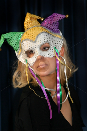 Woman in Masquarade mask stock photo, Portrait of a beautiful young woman with blond hair and a mask by Henrik Lehnerer