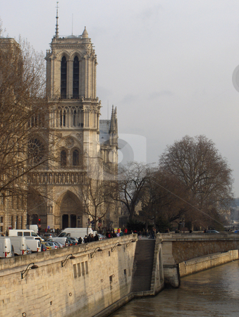 Notre Dame From The Seine stock photo, A view down the Seine River in Paris, taking in the Notre Dame Cathedral and street scene. by Jessica Tooley