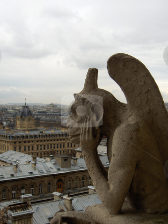 Pensive Gargoyle stock photo, A view of Paris from the Notre Dame Cathedral, with a pensive gargoyle. by Jessica Tooley