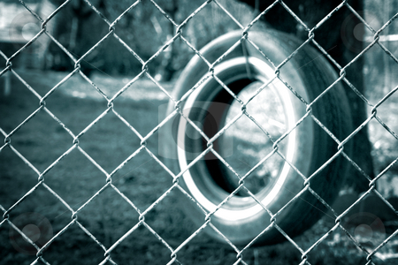 If Only... stock photo, A tire swing hangs from a tree with a chain link fence blocking the way. by Nathan Smith