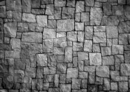 Stone Wall stock photo, Rough-cut blocks of stone interlocked to form a wall. by Nathan Smith