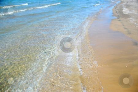 Beach wave sand stock photo, Waves on sandy beach closeup by Elena Elisseeva