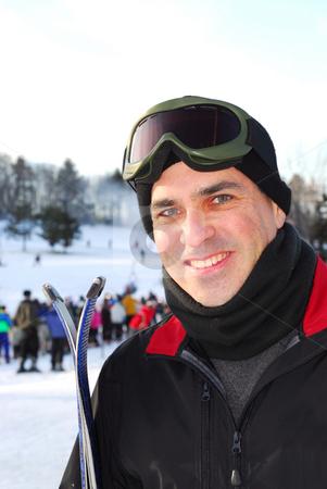 Man ski stock photo, Portrait of a happy attractive man on downhill ski resort by Elena Elisseeva