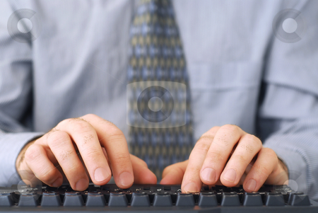 Working on computer stock photo, Closeup of man's hands typing on a keyboard by Elena Elisseeva