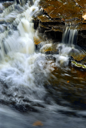 Waterfall stock photo, Waterfall cascading over natural rocks close up by Elena Elisseeva