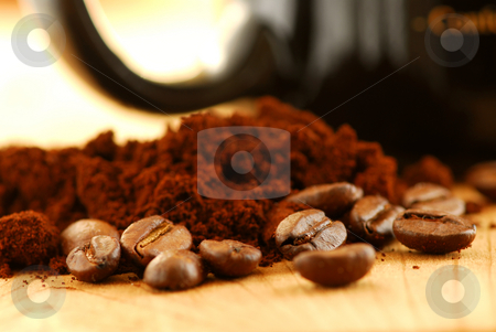 Coffee beans and ground coffee stock photo, Macro image of coffee beans, ground coffee and black coffee mug by Elena Elisseeva