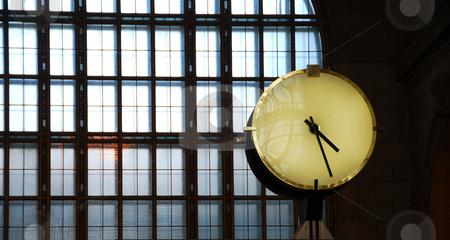 Clock train station stock photo, Big clock inside a train station with big window by Elena Elisseeva