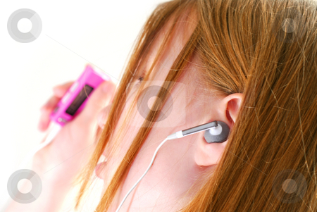 Girl listen music stock photo, Young teendage girl listening to music on her mp3 player by Elena Elisseeva