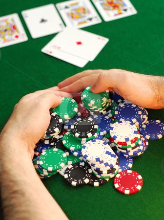 Big win stock photo, Poker player raking a big pile of chips by Elena Elisseeva