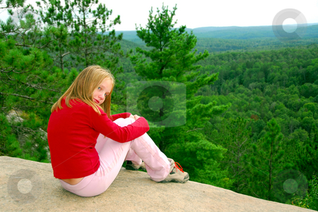 Girl edge cliff stock photo, Young girl sitting on an edge of a cliff by Elena Elisseeva