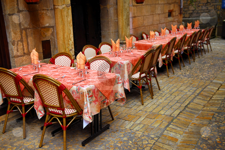 Restaurant patio stock photo, Outdoor restaurant patio on medieval street of Sarlat, Dordogne region, France by Elena Elisseeva