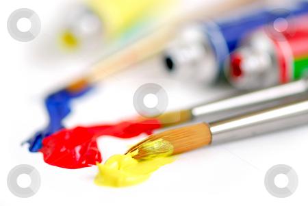 Primary colors paintbrush stock photo, Macro of paintbrushes and paint tubes of primary colors by Elena Elisseeva