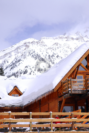 Chalet stock photo, Wooden chalet at downhill ski resort with mountains in background by Elena Elisseeva