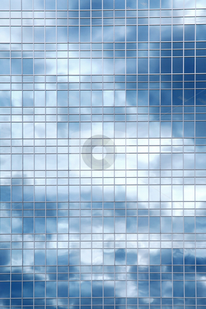 Clouds reflection in office building stock photo, Reflection of a cloudy sky in glass wall of an office building by Elena Elisseeva