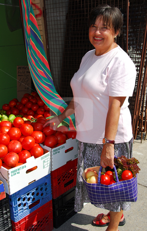 Buying vegetables stock photo, Attractive mature woman buying vegetables at farmer's market by Elena Elisseeva