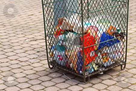 Garbage stock photo, Metal mesh garbage bin in a city park by Elena Elisseeva