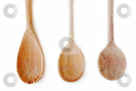 Cooking spoons stock photo, Old wooden cooking spoons isolated on white background by Elena Elisseeva