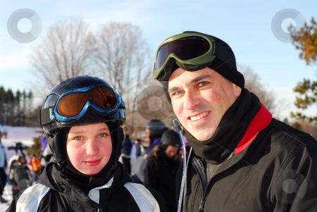 Family ski stock photo, Portrait of a happy family on downhill ski resort by Elena Elisseeva