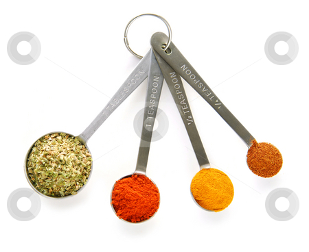 Spices in measuring spoons stock photo, Assorted spices in measuring spoons on white background by Elena Elisseeva