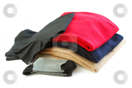 Clothes stock photo, Several items of new clothes isolated on white background by Elena Elisseeva