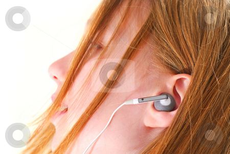 Girl listen music stock photo, Young girl listening to music on her mp3 player by Elena Elisseeva