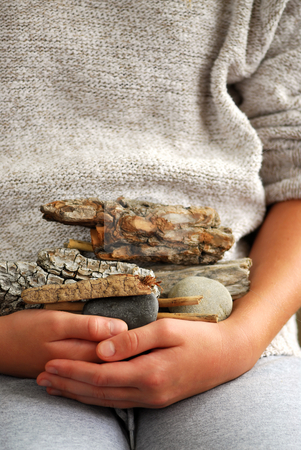 Beach treasures stock photo, Child hands holding beach treasures collected on sea shore by Elena Elisseeva