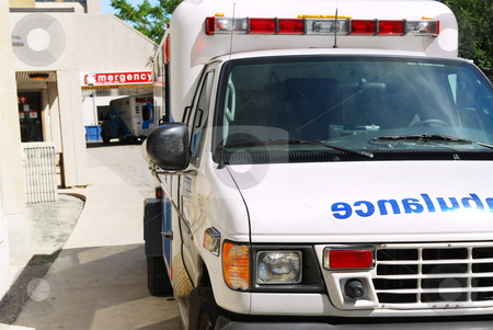 Ambulance at emergency stock photo, Abmulance vehicle in front of an emergency entrance to a hospital by Elena Elisseeva