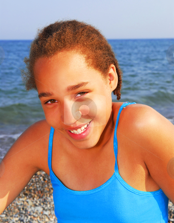 Young girl stock photo, Portrait of a young beautiful girl on sea shore by Elena Elisseeva
