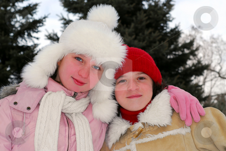 Two girls stock photo, Portrait of two young girls in winter park by Elena Elisseeva