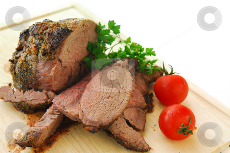 Beef roast stock photo, Beef roast cut on a wooden cutting board by Elena Elisseeva